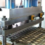 Colheres de madeira formando máquina