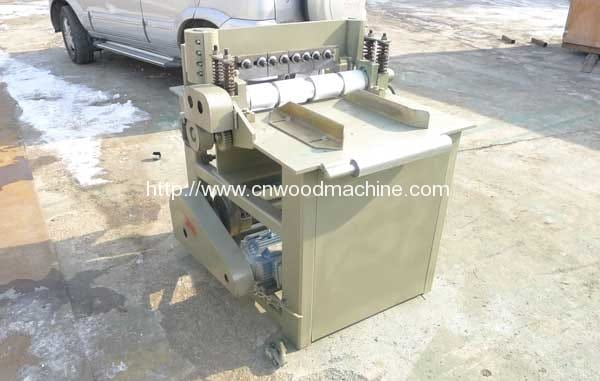 Tri-Carved-Cutting-Machine-for-ice-cream-sticks,-tongue-depressor,-ice-spoon